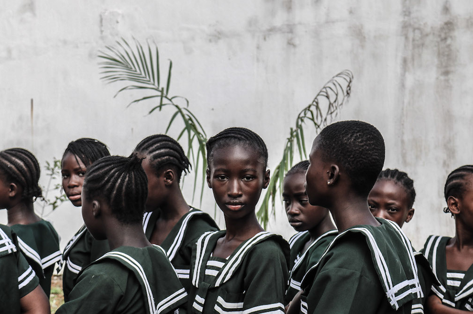 A girl looks into the camera during a parade for International Day of the Girl Child in Monrovia,  Liberia.