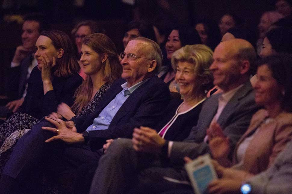 Jennifer Gates, Ray French, and Elaine French, sit in the audience during a talk with John Legend and Melinda Gates