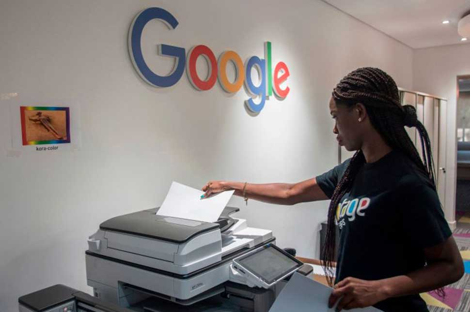A woman makes a copy at the Google Artificial Intelligence office in Ghana
