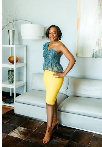 Roshawnna Novelus, CEO of EnrichHER, poses for a portrait leaning up against a wall