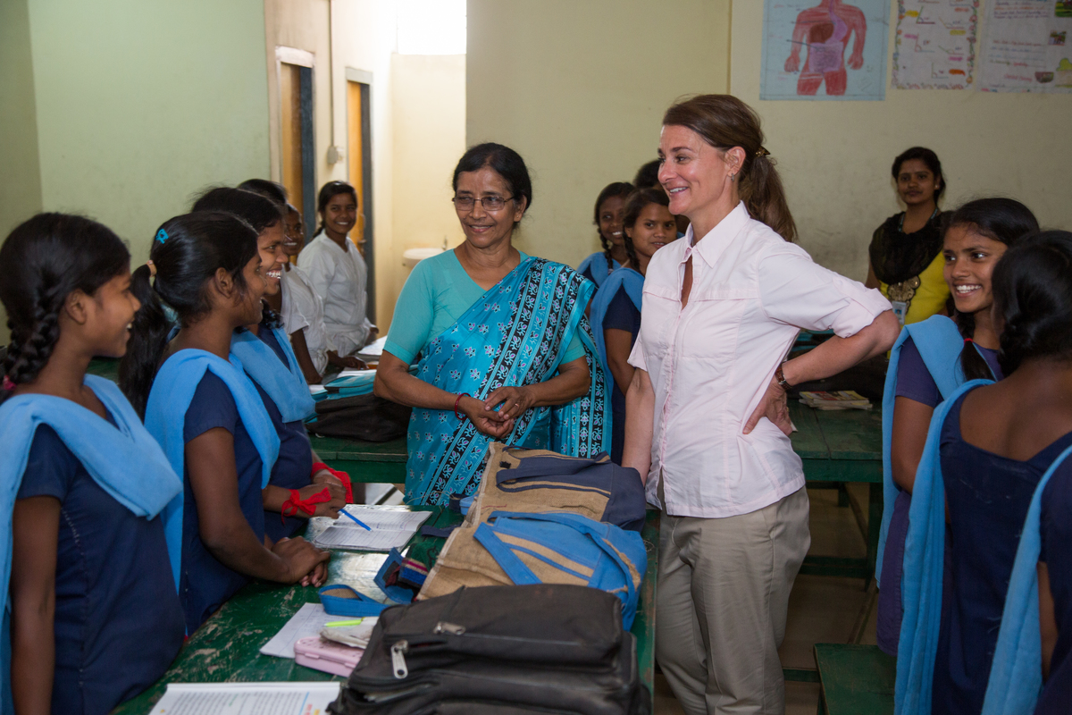 Melinda Gates stands with a group of women at the Prerna School alongside founder Sister Sudha