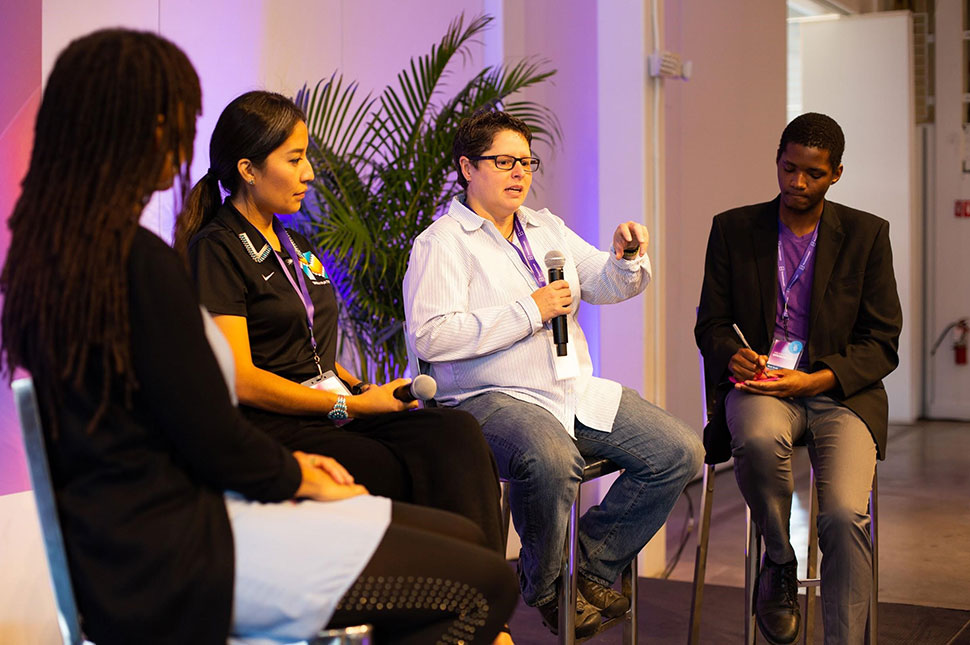 A group of innovators sit on stage speaking at a Headstream panel