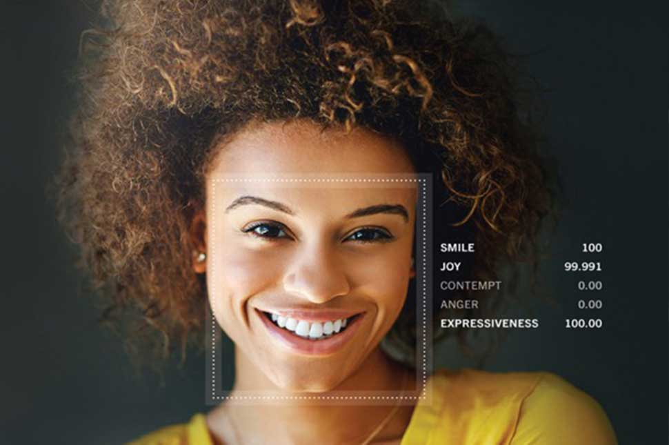 A woman's face is analyzed using Affectiva software