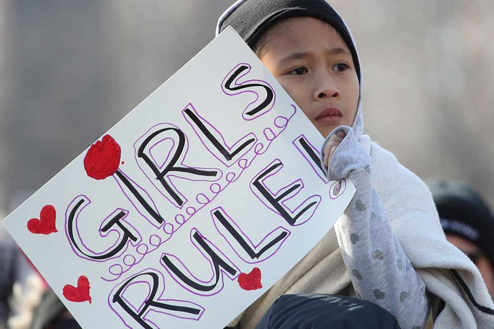 A girl holds a sign as she takes part in the Second Annual Women's March Chicago on January 20, 2018 in Chicago, Illinois.