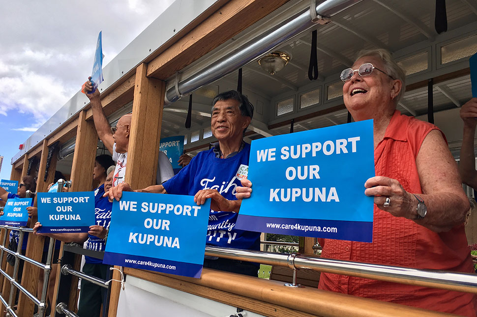 A group of caregivers from Kupuna Caregivers in Hawaii rally support for their cause