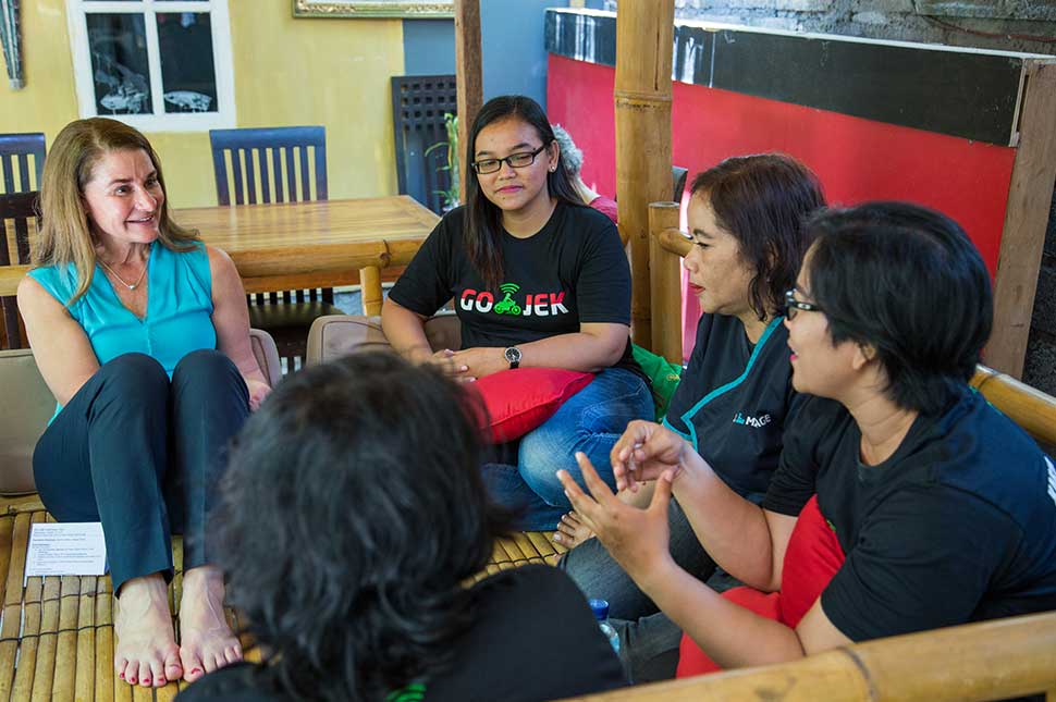 Melinda Gates sits with a group of women from GoJek in Indonesia