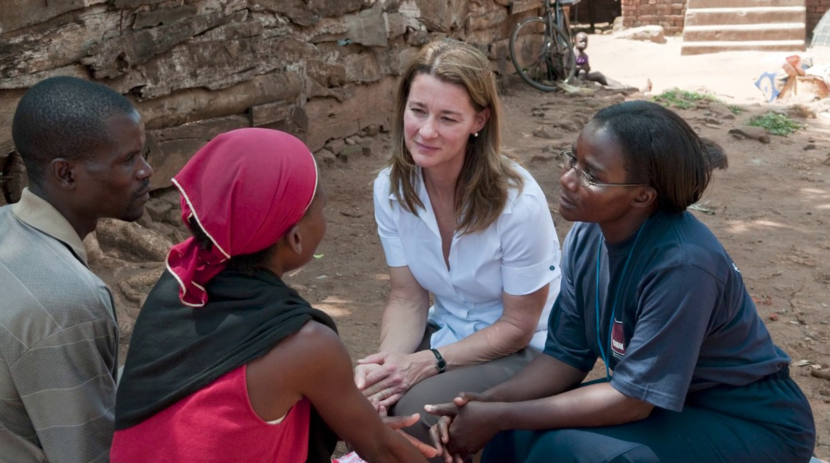 Melinda Gates sits with women in Africa listening to their stories.