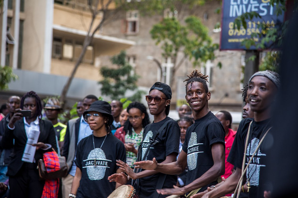 Youth from JIACTIVATE gather and play drums during an event
