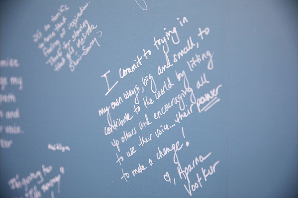 "A zoomed in shot of the Commit to the Lift wall in Chicago. The text reads ""I commit to trying in my own ways, big and small, to contribute to the world by lifting up others and encouraging all to use their voice... their power to make a change!"""