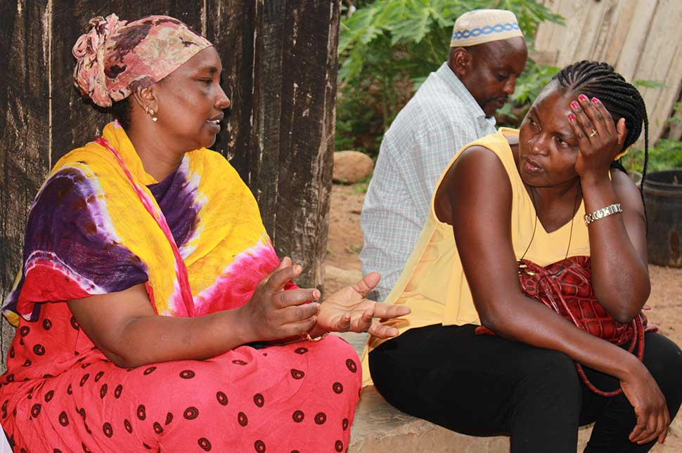 Angela Nguku sits and listens to a women who nearly didn't survive child birth.