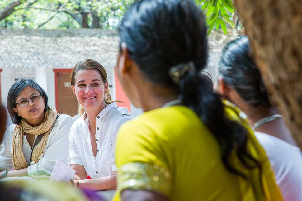 Melinda Gates sits with a group of women who formed a self-help group in Indea