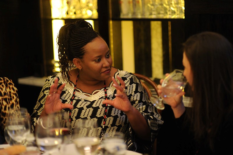 Stella Kiguta speaks with a fellow attendee at TEDWomen, a conference that Pat Mitchell hosts and curates in partnership with TED