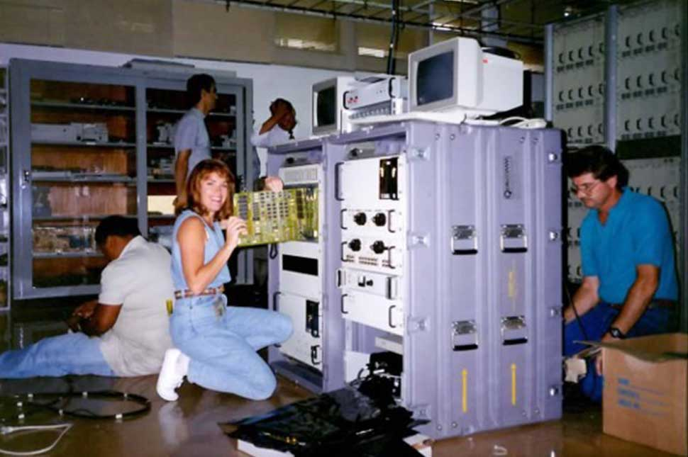 Microsoft EVP Peggy Johnson, who began her tech career as an electrical engineer in the late 1980s, helps install a satellite base station for Qualcomm in Brazil.