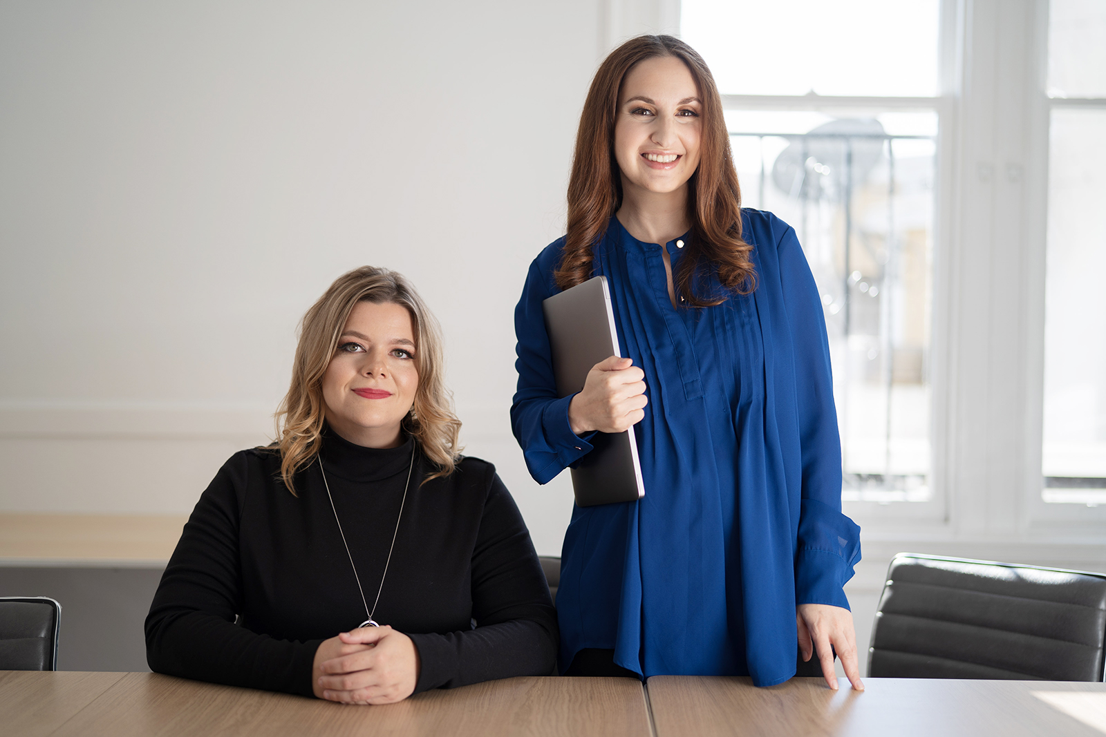 Cofounders of care giving startup Winnie, Sara Mauskopf and Anne Halsall, pose for a portrait in the boardroom.