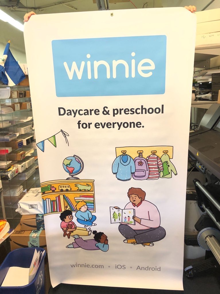 """A banner hanging in a print shop with the logo for Winnie and text below reading """"Daycare and Preschool for everyone"""""""