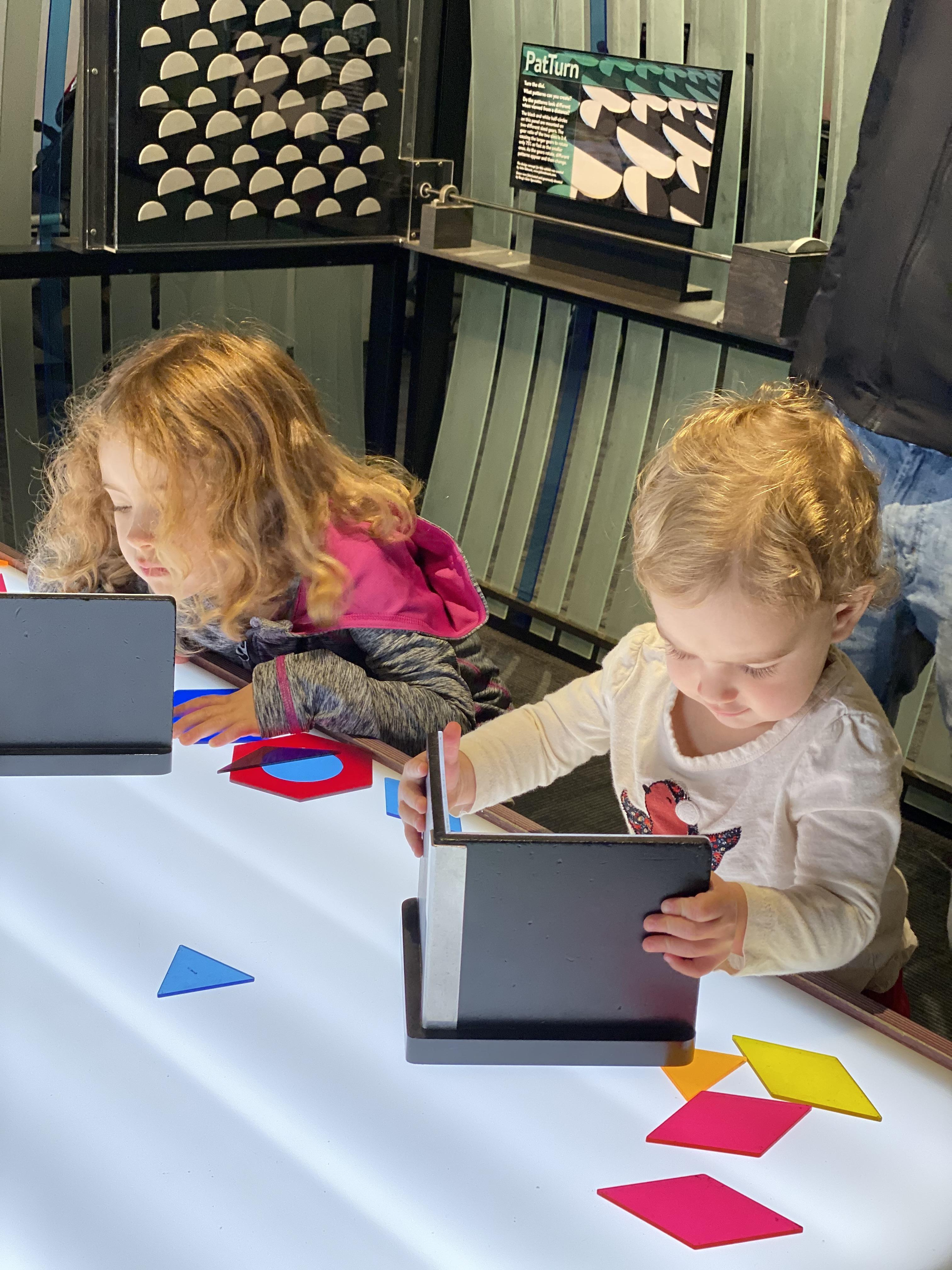 Sara Mauskopf's two daughters play with books at a local museum
