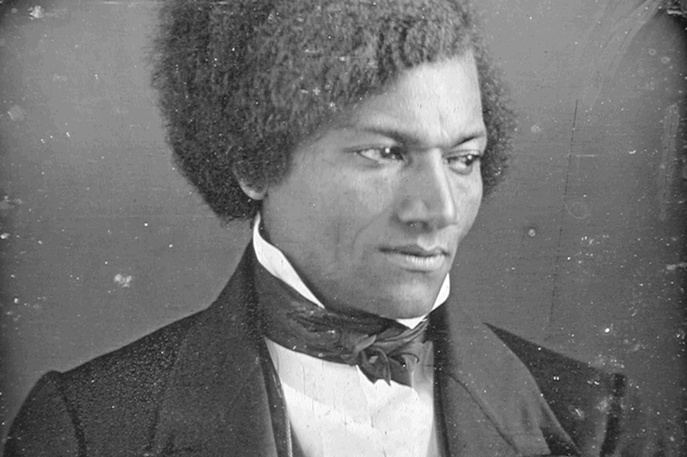 A black and white portrait of suffragist Frederick Douglass