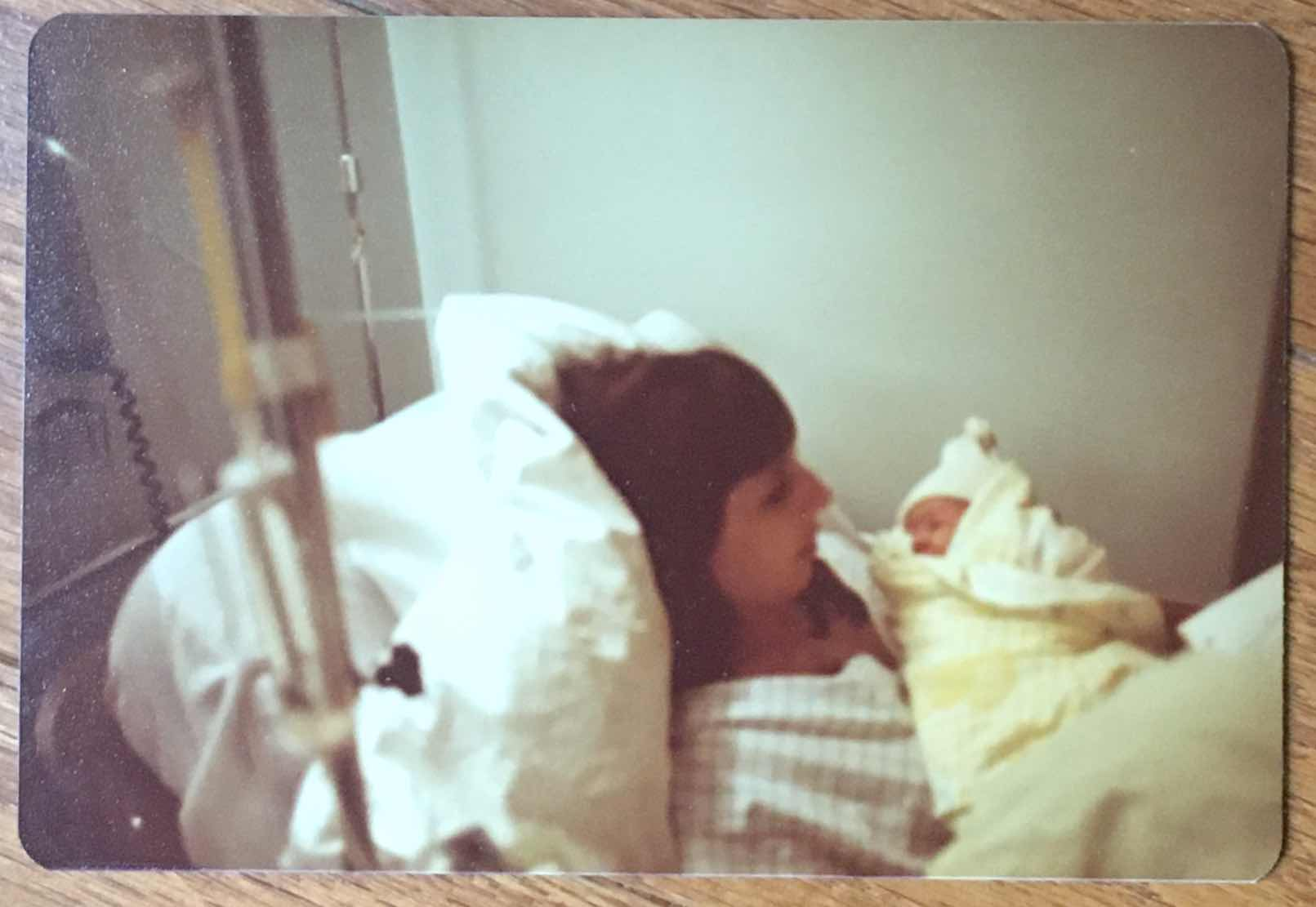 Maggie Lemere's mother holds Maggie in a hospital bed shortly after giving birth