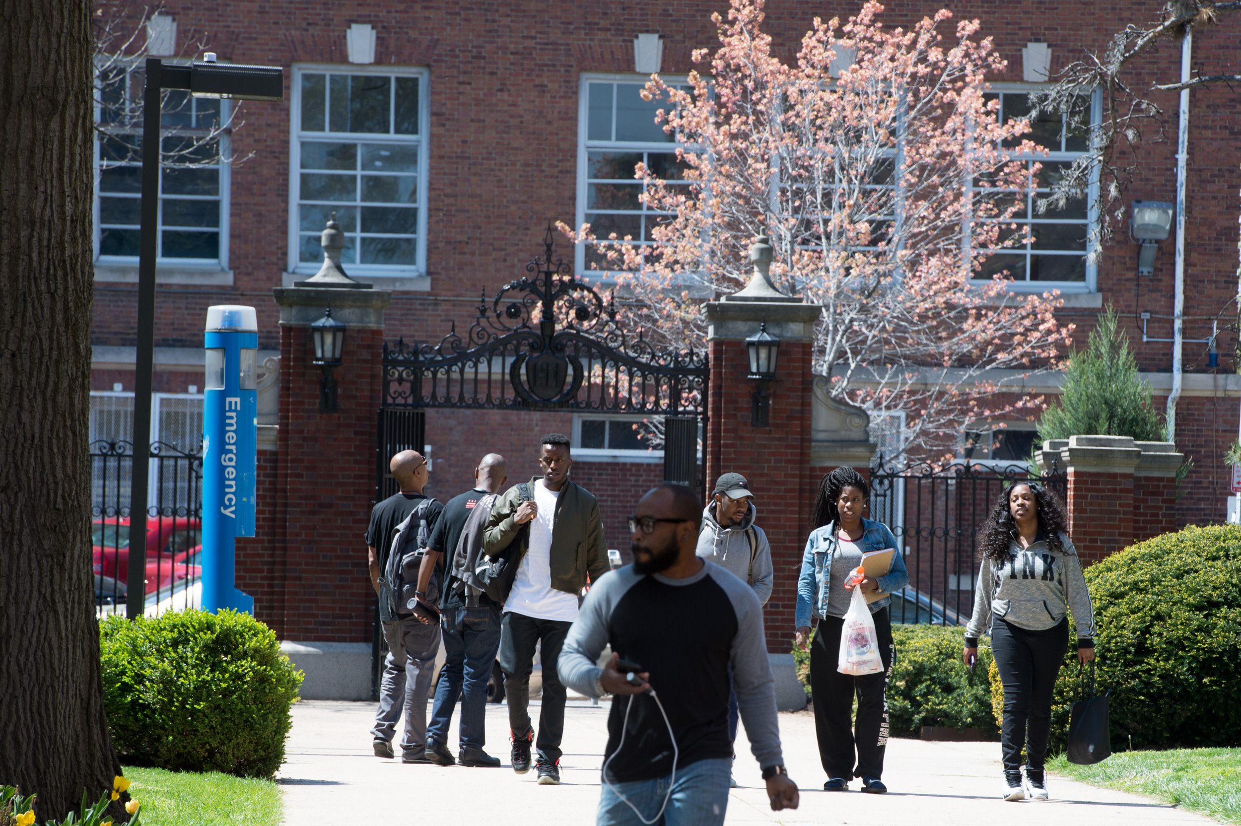 Students walk through a gate on campus at Howard University