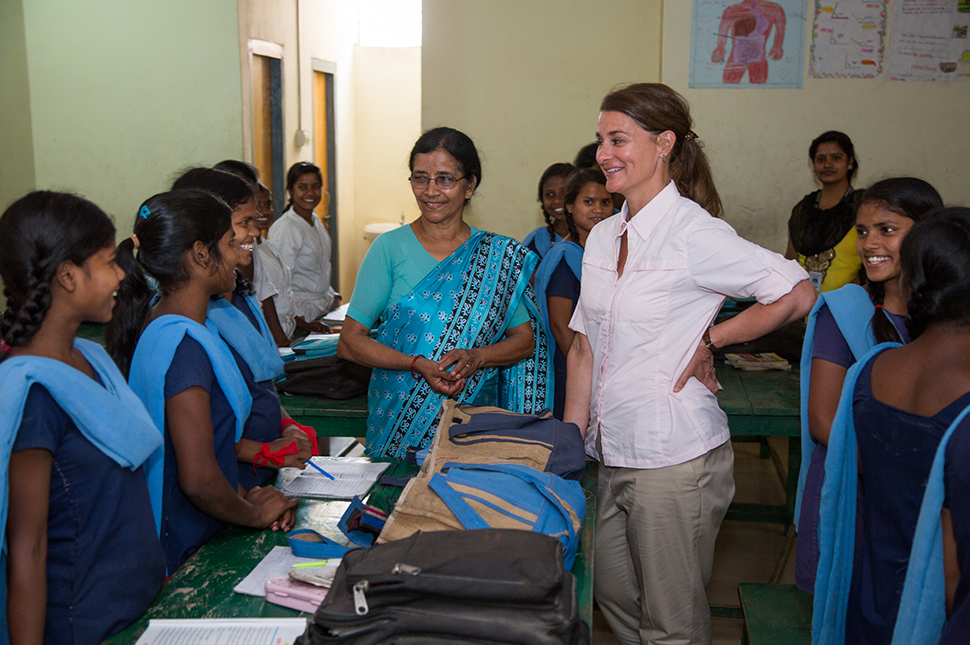 Melinda Gates standing and talking to a group of girls at Prerna School
