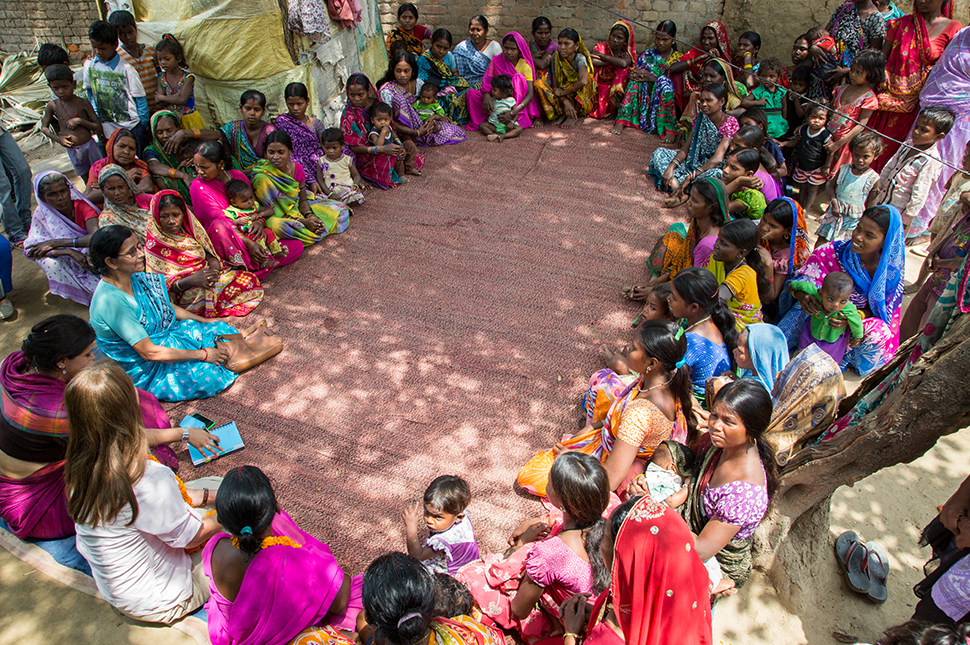 Melinda Gates sitting in a group circle with women and girls from the Prerna School
