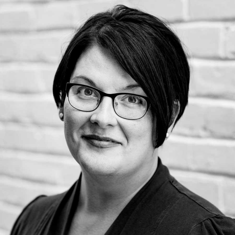 Professional headshot portrait of Katie Jett Walls