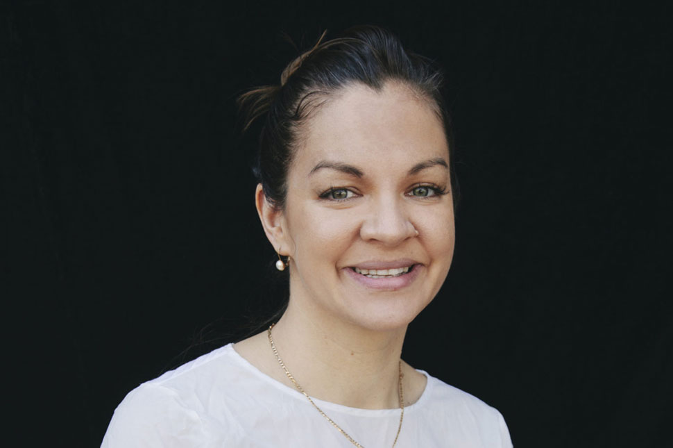 Professional portrait of Elisha London, Founder and CEO of United for Global Mental Health