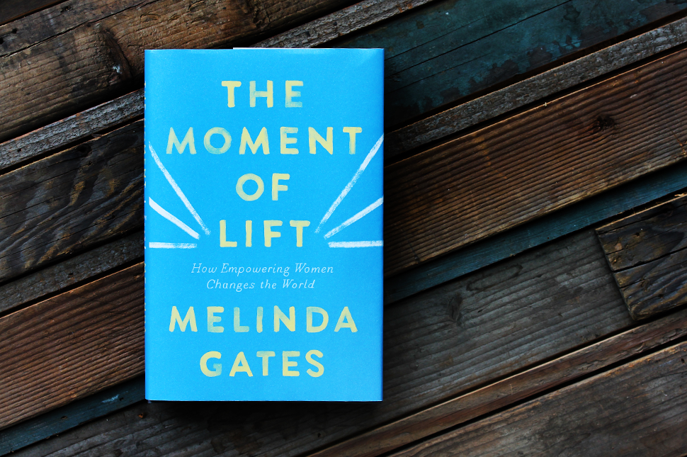 "Melinda Gates' new book ""The Moment of Lift"" sits on a wooden table."